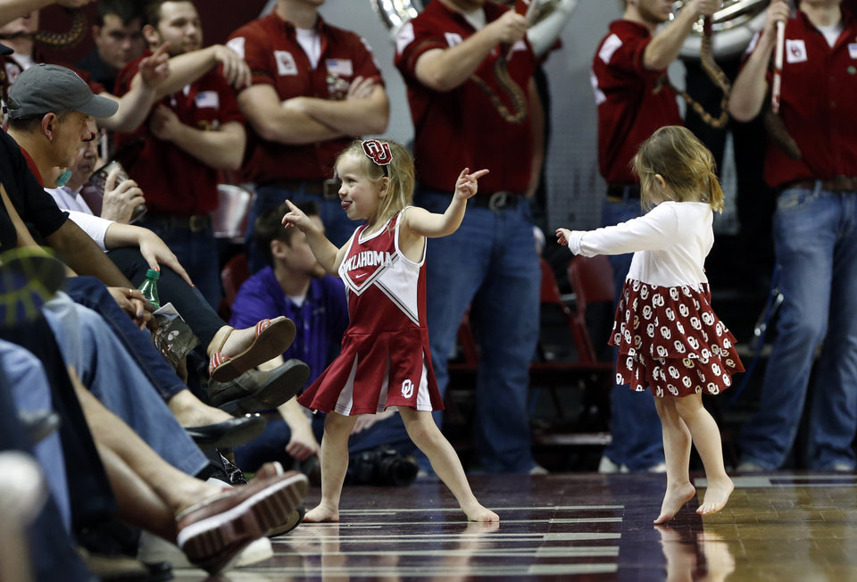 Photo - Little fans celebrate as the University of Oklahoma Sooner (OU) men defeat the Kansas State Wildcats (KS) 86-73 in NCAA, college basketball at The Lloyd Noble Center on Saturday, Feb. 22, 2014 in Norman, Okla. Photo by Steve Sisney, The Oklahoman
