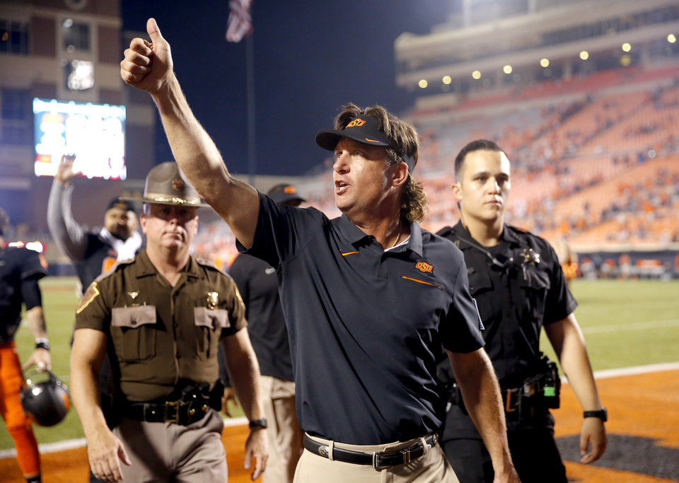 Photo - Oklahoma State head coach Mike Gundy fives the student section a thumbs up following the college football game between the Oklahoma State Cowboys and the Kansas State Wildcats at Boone Pickens Stadium in Stillwater, Okla., Saturday, Sept. 28, 2019.  OSU won 26-13. [Sarah Phipps/The Oklahoman]