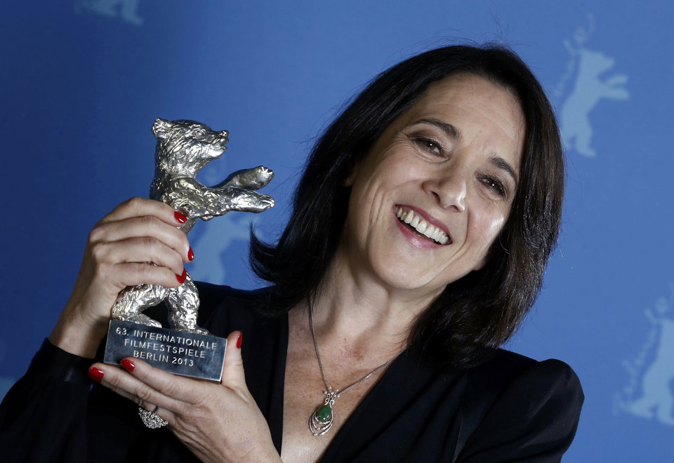 "Actress Paulina Garcia poses backstage with her Silver Bear award as Best Actress for the movie ""Gloria"" during the awards ceremony at the 63rd Berlinale International Film Festival in Berlin Saturday, Feb. 16, 2013. (AP Photo/Thomas Peter, pool)"