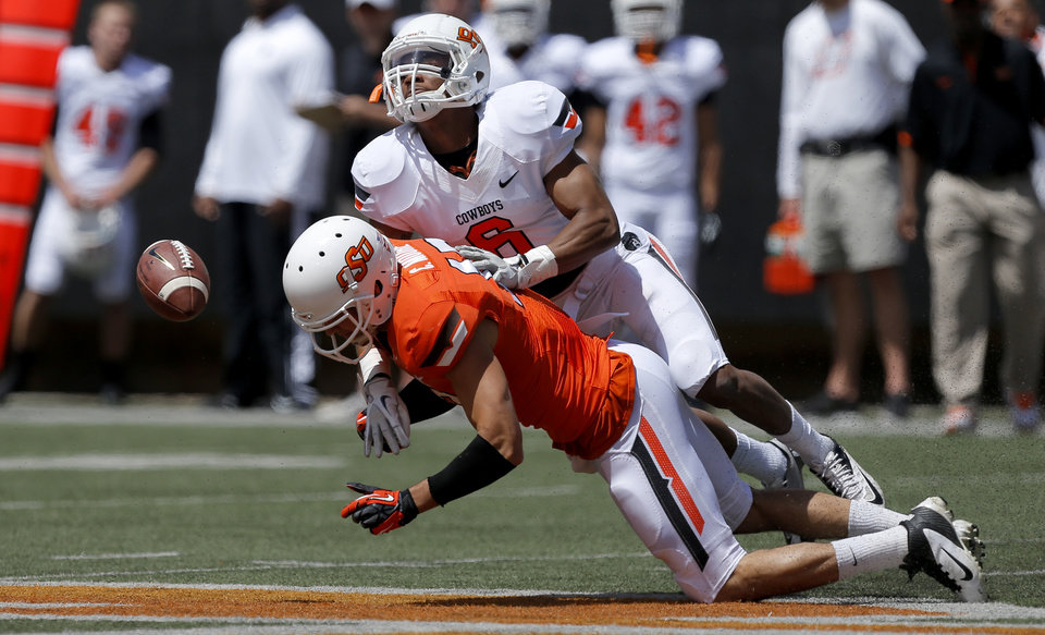 Oklahoma State's Ashton Lampkin, top, breaks up a pass intended for Charlie Moore during OSU's spring football game at Boone Pickens Stadium in Stillwater, Okla., Sat., April 20, 2013. Photo by Bryan Terry, The Oklahoman