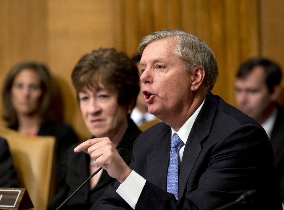 "FILE - In this June 6, 2013, photo, Sen. Lindsey Graham, R-S.C., right, joined by Sen. Susan Collins, R-Maine, left, addresses Attorney General Eric Holder as he testifies at a Senate Appropriations subcommittee as lawmakers examine the budget for the Justice Department, on Capitol Hill in Washington. Revelations of massive government collections of Americans' phone and email records have reinvigorated an odd-couple political alliance of the far left and right. ""This is a marginal national security group within our party,""  Graham said of those who call the government snooping unwarranted or unconstitutional. ""I just don't see how anybody gets elected as a Republican"" by running to the ""left of Obama on national security,"" said Graham, one of the Senate's most hawkish members. (AP Photo/J. Scott Applewhite)"