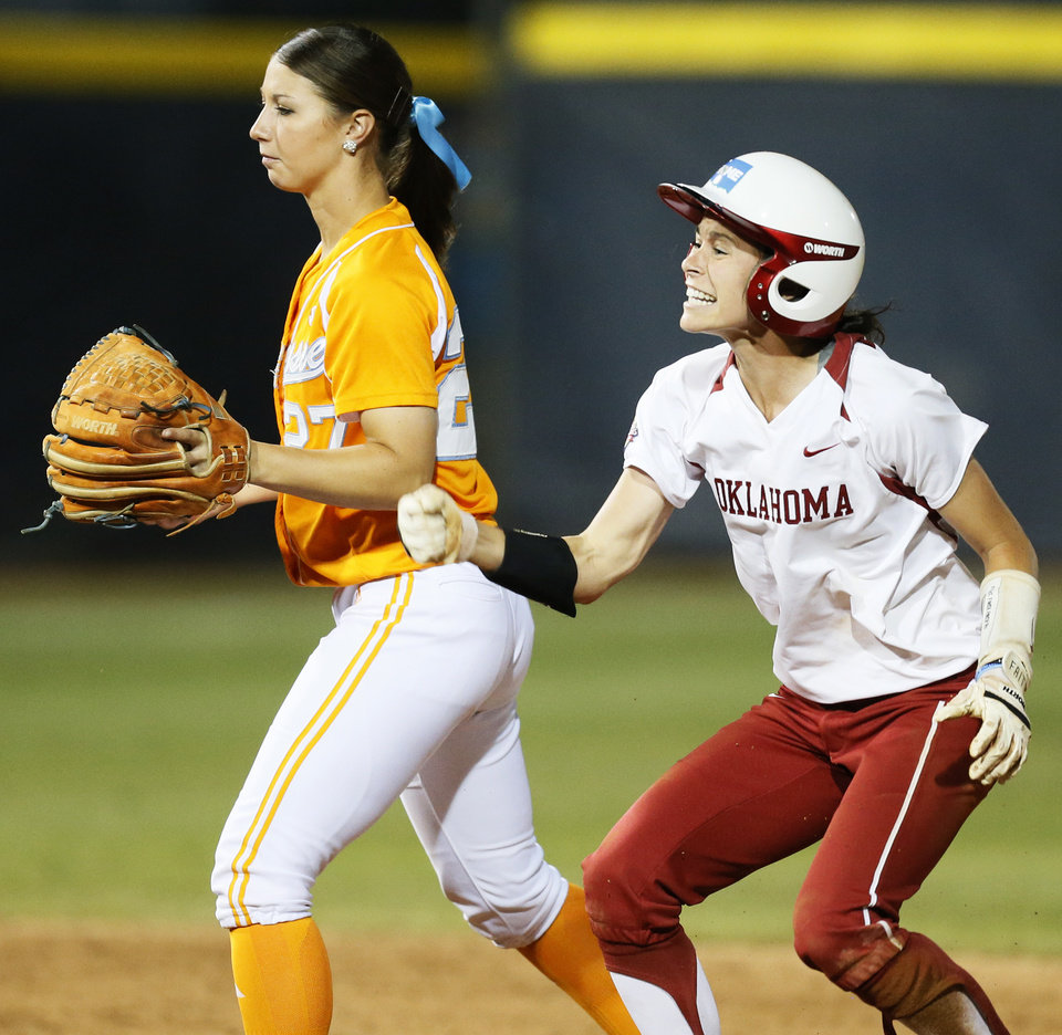 Photo - OU's Brianna Turang (2) reacts next to Tennessee's Lauren Gibson (27) after Turang doubled in the twelfth inning during Game 1 of the Women's College World Series NCAA softball championship series between Oklahoma and Tennessee at ASA Hall of Fame Stadium in Oklahoma City, Monday, June 3, 2013. OU won 5-3 in 12 innings. Photo by Nate Billings, The Oklahoman