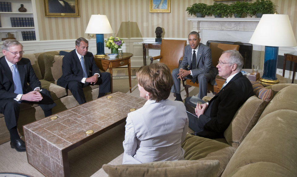 Photo - President Barack Obama meets with, from left, Senate Minority Leader Mitch McConnell of Ky., House Speaker John Boehner of Ohio, House Minority Leader Nancy Pelosi of Calif., and Senate Majority Leader Harry Reid of Nev., in the Oval Office of the White House in Washington, Wednesday, June 18, 2014. Obama briefed leaders of Congress on US options for blunting an Islamic insurgency in Iraq. US officials say Obama is not yet prepared to move forward with strikes and is instead focused on increased training for Iraq's security forces, boosting Iraqi intelligence capacities and upgrading equipment. (AP Photo/Pablo Martinez Monsivais)