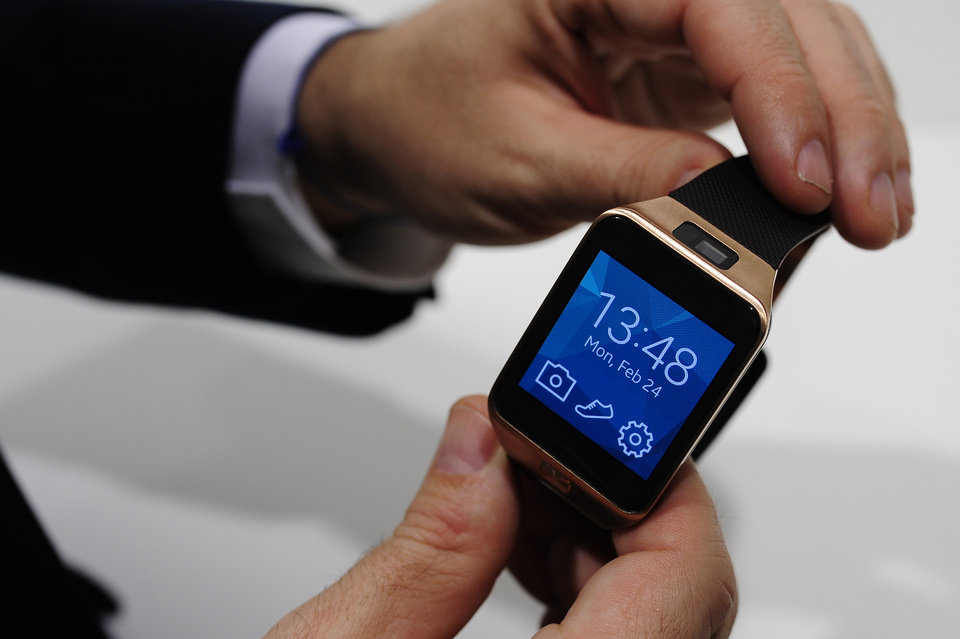 Photo - FILE - In this Feb. 24, 2014 file photo, the Samsung Gear 2 smartwatch is displayed at the Mobile World Congress in Spain. The Gear 2 line doesn't use Android Wear, but a fledging system called Tizen. Samsung says that helps extend battery life to two or three days, instead of the single day on the original, Android-based Galaxy Gear. Unlike the Android Wear watches, the Gear 2 and the Gear 2 Neo both require a Samsung phone. (AP Photo/Manu Fernandez, File)