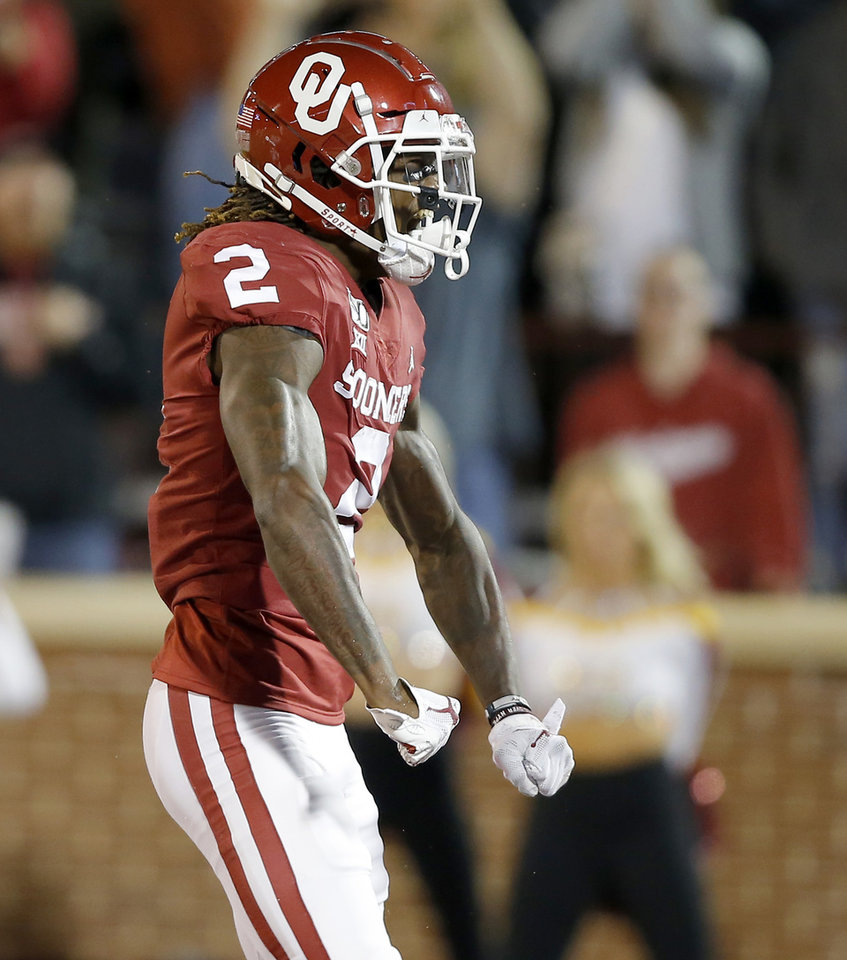 Photo - Oklahoma's CeeDee Lamb (2) celebrates after scoring a touchdown during an NCAA football game between the University of Oklahoma Sooners (OU) and the Iowa State University Cyclones at Gaylord Family-Oklahoma Memorial Stadium in Norman, Okla., Saturday, Nov. 9, 2019. [Bryan Terry/The Oklahoman]