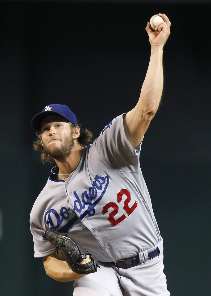 Photo - Los Angeles Dodgers' Clayton Kershaw throws a pitch against the Arizona Diamondbacks during the first inning of a baseball game Wednesday, Aug. 27, 2014, in Phoenix. (AP Photo/Ross D. Franklin)