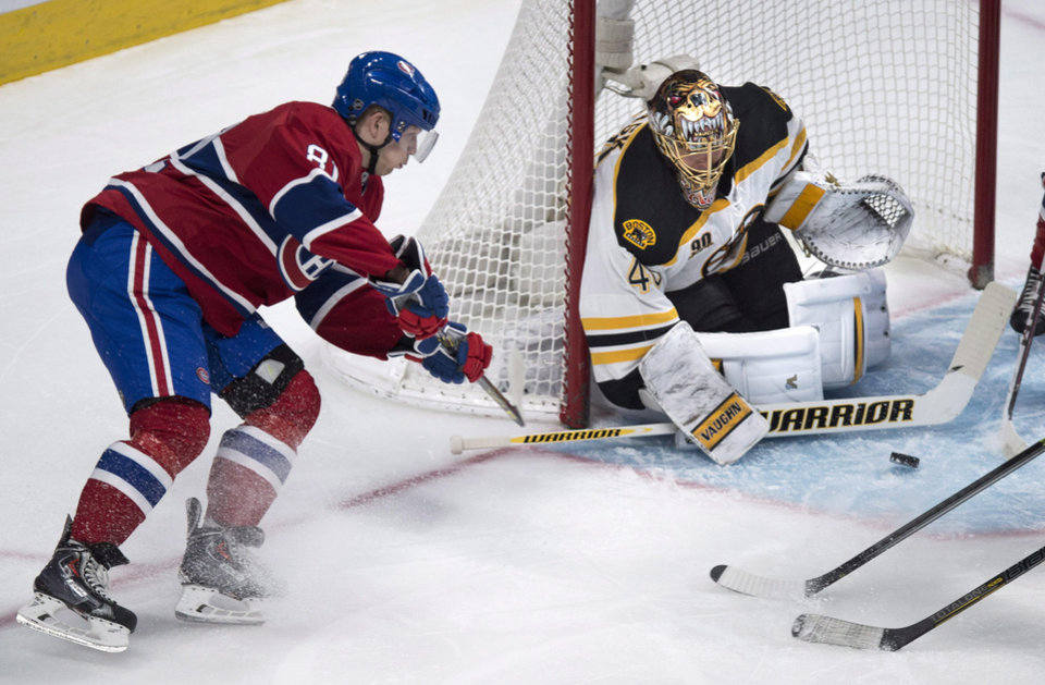 Photo - Montreal Canadiens' Lars Eller tries to score on the wrap-around past Boston Bruins goalie Tuukka Rask during first period NHL hockey action Wednesday, March 12, 2014 in Montreal. (AP Photo/The Canadian Press, Paul Chiasson)
