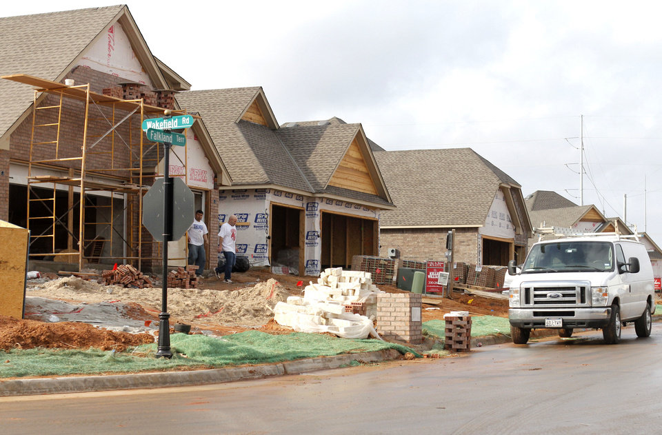 New single-family housing construction permits in Edmond are on the rise. Two streets of new homes are being built in Hampden Hallow, northeast of Covell Road and Air Depot Boulevard. PHOTO BY PAUL HELLSTERN, THE OKLAHOMAN. PAUL HELLSTERN - THE OKLAHOMAN