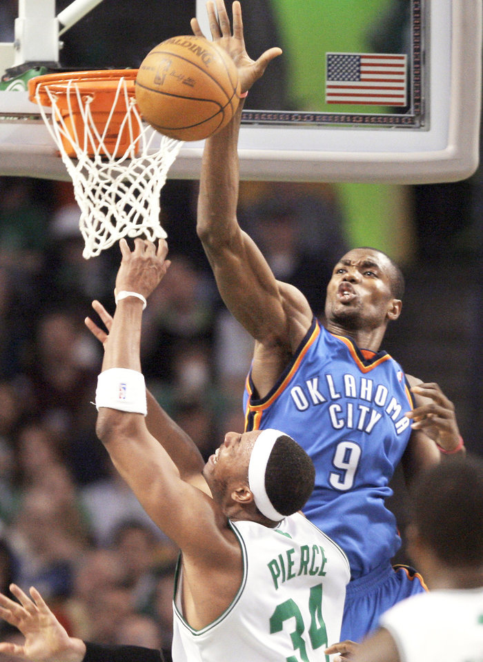 OKC's Serge Ibaka, right, blocks a shot by Boston's Paul Pierce during Wednesday night's game  in Boston. The Thunder won 109-104. AP photo