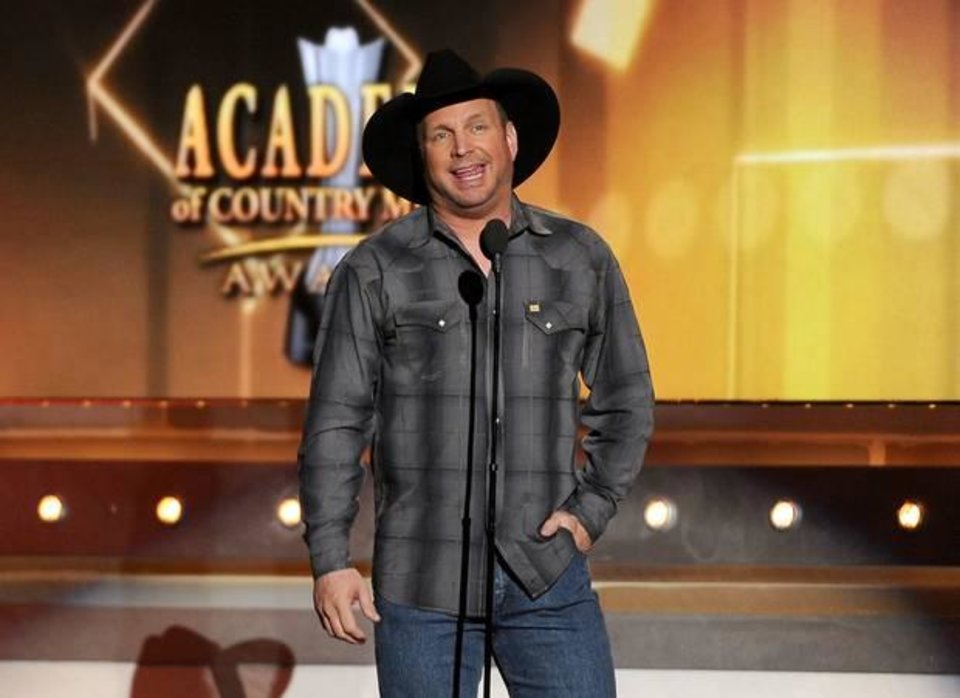 Photo -  Garth Brooks speaks on stage at the 49th annual Academy of Country Music Awards at the MGM Grand Garden Arena on Sunday, April 6, 2014, in Las Vegas. (AP)