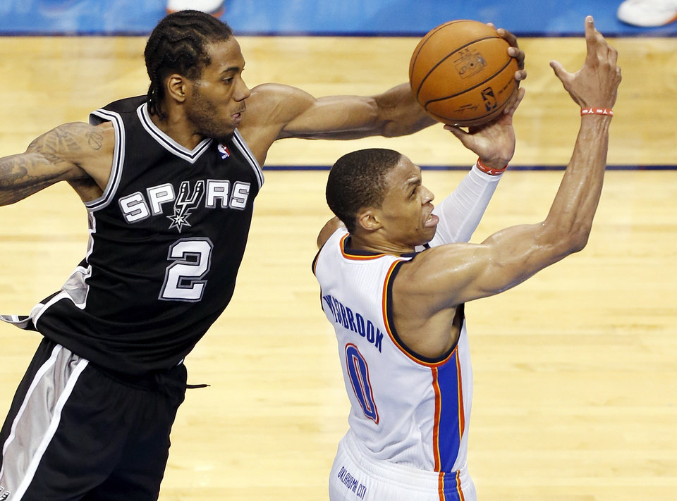 Photo - San Antonio's Kawhi Leonard (2) blocks the shot of Oklahoma City's Russell Westbrook (0) in overtime during Game 6 of the Western Conference Finals in the NBA playoffs between the Oklahoma City Thunder and the San Antonio Spurs at Chesapeake Energy Arena in Oklahoma City, Saturday, May 31, 2014. The Spurs won 112-107 in overtime. Photo by Nate Billings, The Oklahoman