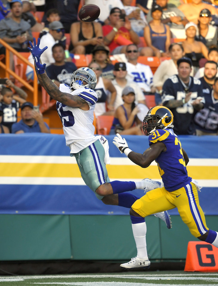 Photo - CORRECTS TO SECOND HALF INSTEAD OF FIRST HALF - Dallas Cowboys wide receiver Devin Smith, left, makes a touchdown catch as Los Angeles Rams defensive back Darious Williams defends during the second half of a preseason NFL football game Saturday, Aug. 17, 2019, in Honolulu. (AP Photo/Mark J. Terrill)
