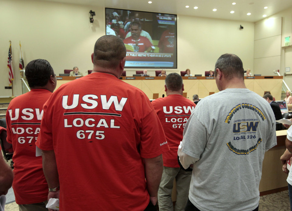 Photo -   Members of the United Steel Workers in joined dozens of others calling for the California Air Resources Board to reconsider the state's pending cap-and-trade program for carbon emissions, during a hearing Thursday, Sept. 20, 2012, in Sacramento, Calif. The board took testimony from experts and the public on the the cost to businesses and consumers with the implementation of AB32, California's landmark greenhouse gas emissions law. (AP Photo/Rich Pedroncelli)