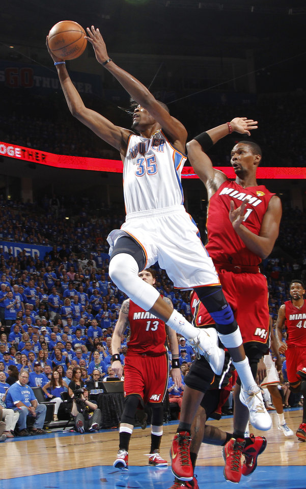 Oklahoma City's Kevin Durant (35) goes past Miami's Chris Bosh (1) during Game 1 of the NBA Finals between the Oklahoma City Thunder and the Miami Heat at Chesapeake Energy Arena in Oklahoma City, Tuesday, June 12, 2012. Photo by Chris Landsberger, The Oklahoman