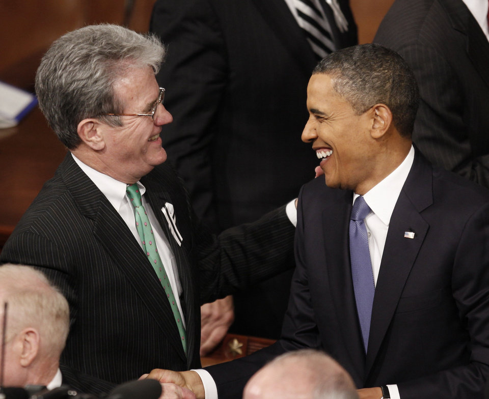 President Barack Obama greets Sen. Tom Coburn, R-Okla., on Capitol Hill in Washington, Tuesday, Jan. 25, 2011, before the president delivered his State of the Union address.  (AP Photo/Evan Vucci) ORG XMIT: CAP144
