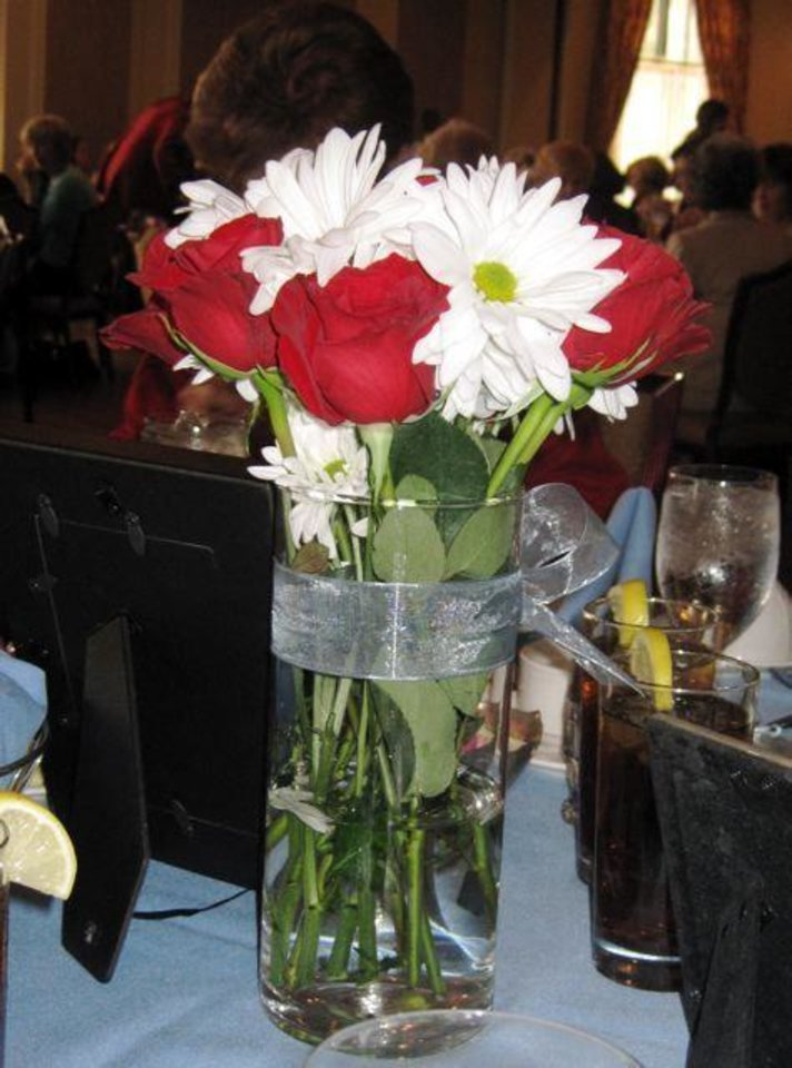 GATHERING OF ANGELS...Pretty centerpieces at the luncheon. (Photo by  Helen Ford Wallace).