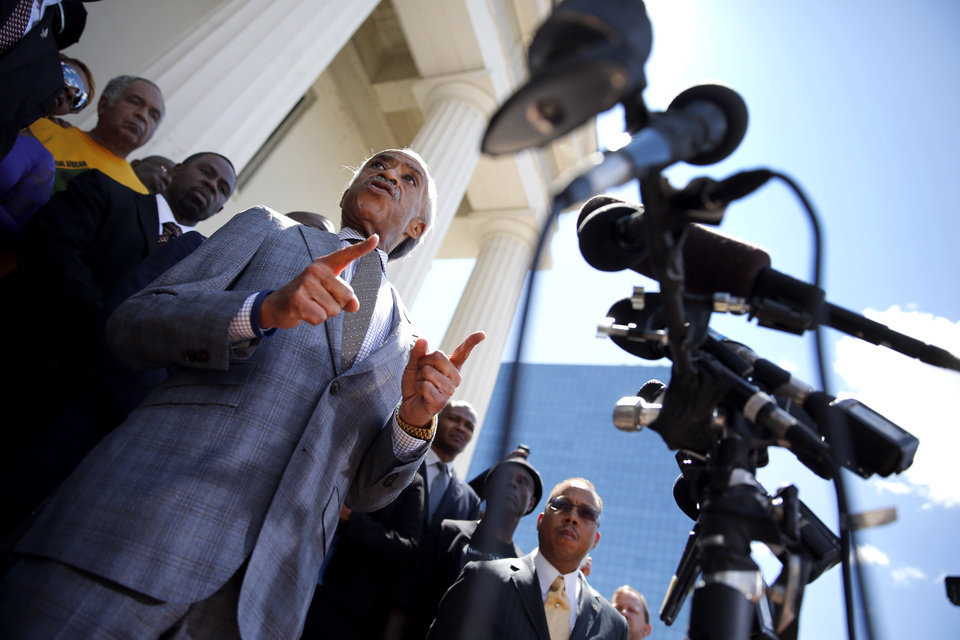 Photo - Civil rights leader Rev. Al Sharpton speaks during a news conference outside the Old Courthouse Tuesday, Aug. 12, 2014, in St. Louis. Michael Brown Jr., 18, who was unarmed, was shot to death Saturday by a Ferguson police officer while walking with a friend down the center of the street. (AP Photo/Jeff Roberson)