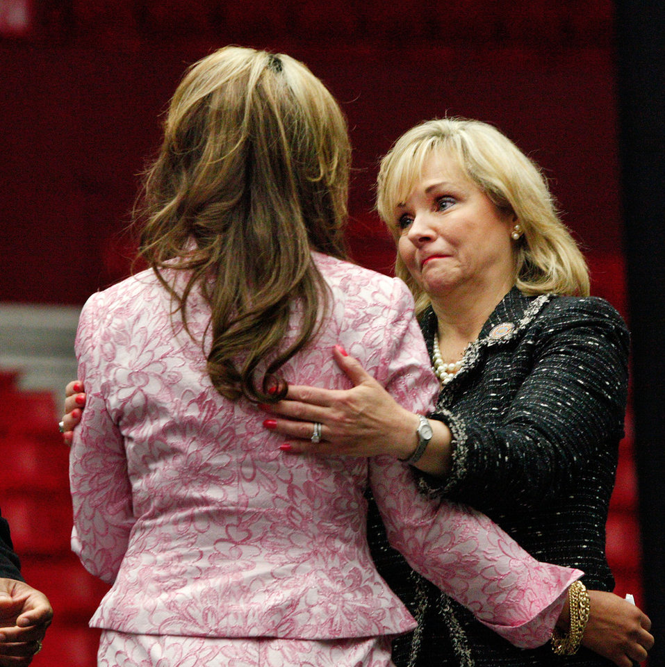 Photo - Gov. Mary Fallin, right, speaks to daughter Chelle Luper Wilson after Wilson deliverd her comments about her mother. About 2,500 people celebrated the life and legacy of Oklahoma City civil rights pioneer Clara Mae Shepard Luper  during a lively service in the Cox Convention Center that lasted more than three hours, Friday,  June 17, 2011.  Luper died  last week at the age of 88. Photo by Jim Beckel, The Oklahoman