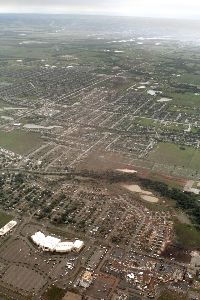 The path of the May 20th tornado can be seen looking west in Moore, OK, Tuesday, May 21, 2013,  By Paul Hellstern, The Oklahoman