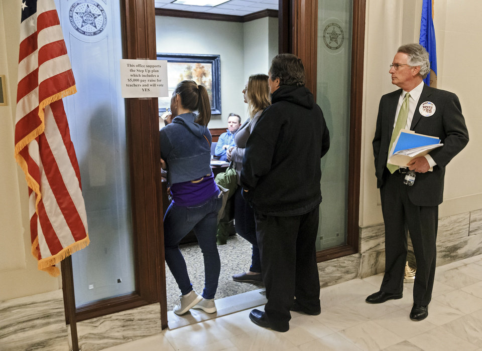 Photo - Step Up Oklahoma supporter David Rainbolt listens in as Speaker of the House Charles McCall talks with teachers in his office during a rally to support the Step Up Oklahoma Plan at the state capitol in Oklahoma City, Okla. on Monday, Feb. 12, 2018.    Photo by Chris Landsberger, The Oklahoman