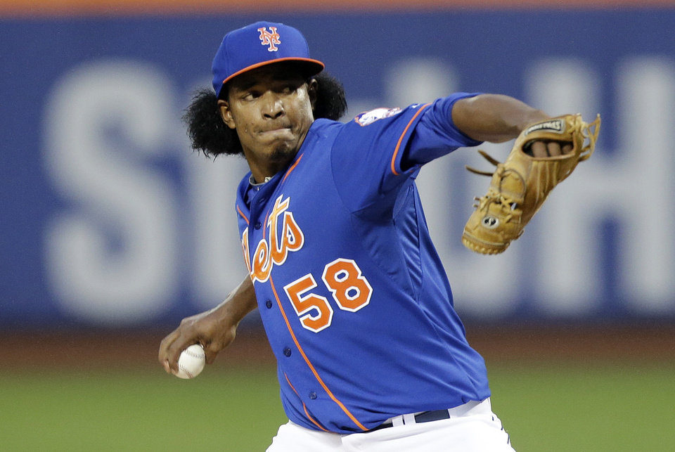 Photo - New York Mets' Jenrry Mejia delivers a pitch during the first inning of a baseball game against the Philadelphia Phillies, Friday, May 9, 2014, in New York. (AP Photo/Frank Franklin II)