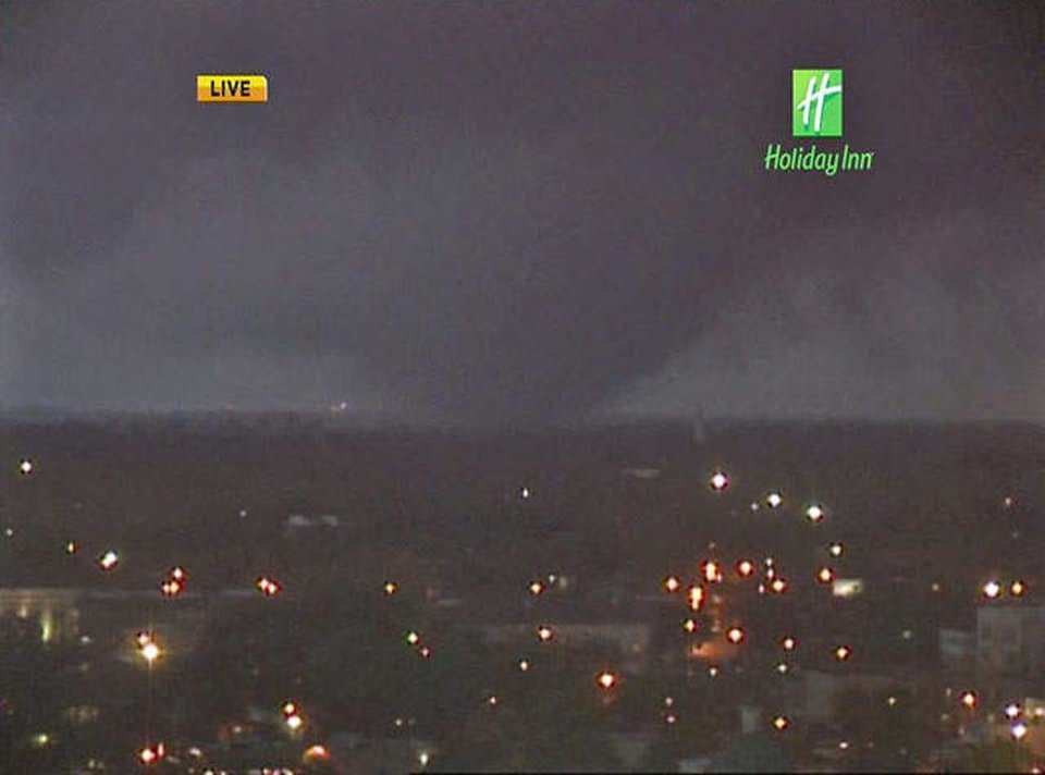 Photo - In this image from video provided by WALA-TV in Mobile, Ala. a tornado touches down in Mobile on Tuesday, Dec. 25, 2012. The tornado hit some areas of downtown Mobile Tuesday, causing severe damage in the area before moving north, officials said. (AP Photo/WALA-TV) MANDATORY CREDIT: WALA-TV