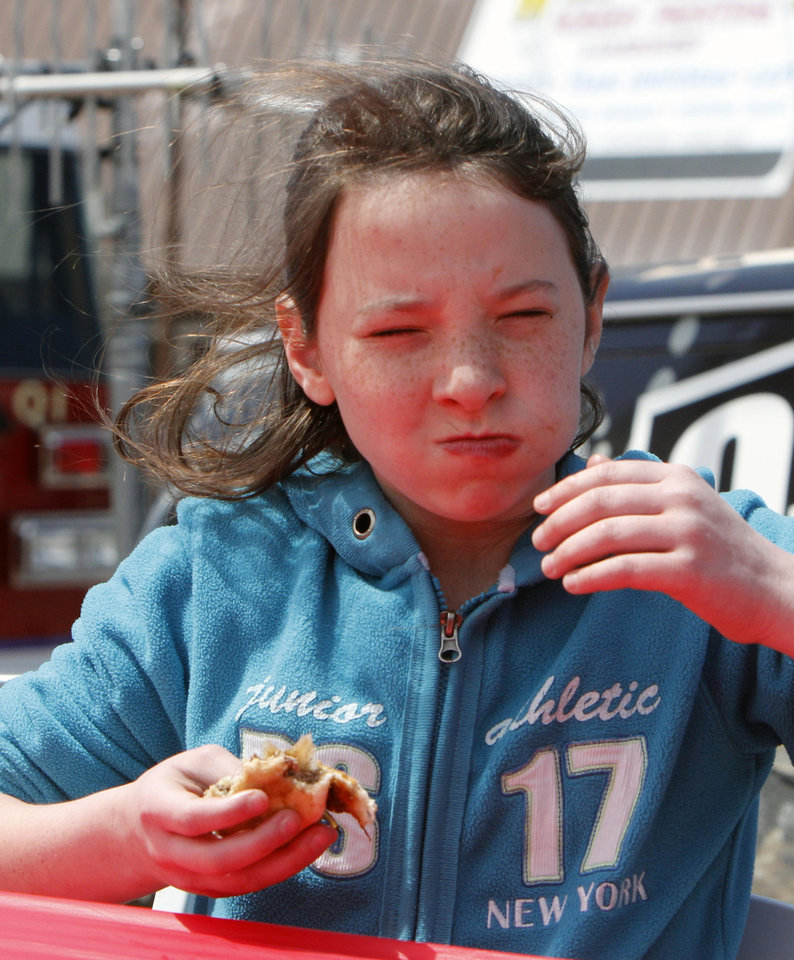Eleven year old Jasmine O\'Neal competes in the children\'s burger eating competition during the Fabulous Burger Day Festival in El Reno, OK, Saturday, May 4, 2013, By Paul Hellstern, The Oklahoman