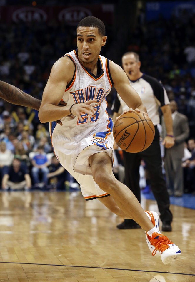 Photo - Oklahoma City Thunder's Kevin Martin (23) drives as the Oklahoma City Thunder play the Atlanta Hawks in NBA basketball at the Chesapeake Energy Arena in Oklahoma City, on Sunday, Nov. 4, 2012.  Photo by Steve Sisney, The Oklahoman