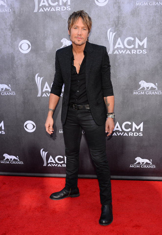Photo - Keith Urban arrives at the 49th annual Academy of Country Music Awards at the MGM Grand Garden Arena on Sunday, April 6, 2014, in Las Vegas. (Photo by Al Powers/Powers Imagery/Invision/AP)