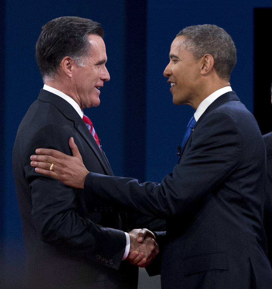 Photo -   Republican presidential candidate, former Massachusetts Gov. Mitt Romney shakes hands with President Barack Obama before the start of the third presidential debate on Monday, Oct. 22, 2012, in Boca Raton, Fla. (AP Photo/ Evan Vucci)