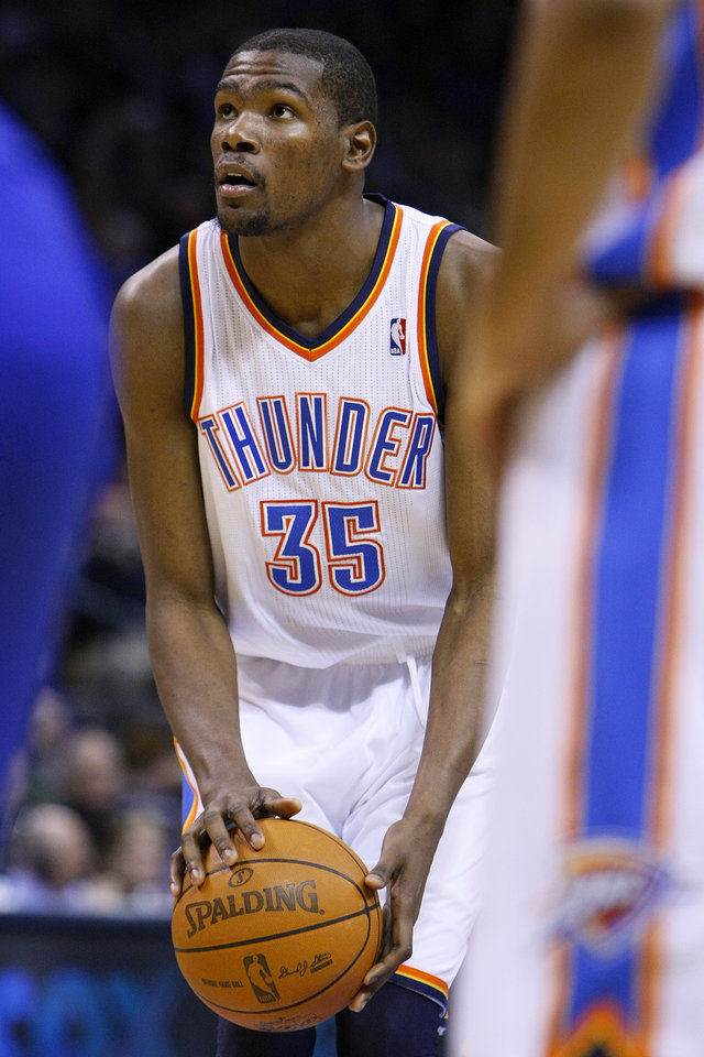 Photo - Oklahoma City's Kevin Durant gets set to shoot a free throw during the Thunder - Warriors game Sunday, December 5, 2010 at the Oklahoma City Arena. Photo by Hugh Scott, The Oklahoman