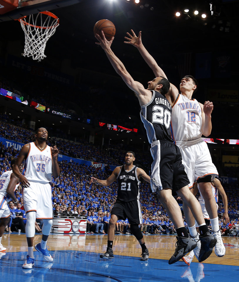 Photo - San Antonio's Manu Ginobili (20) shoots a lay up as Oklahoma City's Steven Adams (12) defends during Game 3 of the Western Conference Finals in the NBA playoffs between the Oklahoma City Thunder and the San Antonio Spurs at Chesapeake Energy Arena in Oklahoma City, Sunday, May 25, 2014. Photo by Bryan Terry, The Oklahoman