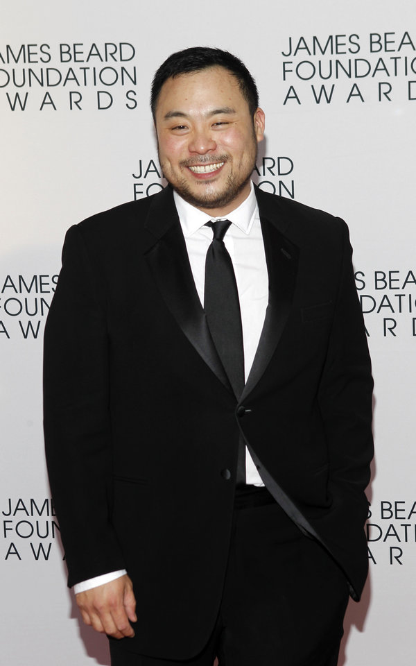 Photo -   Chef David Chang arrives for the James Beard Foundation Awards, Monday, May 7, 2012, in New York. (AP Photo/Jason DeCrow)