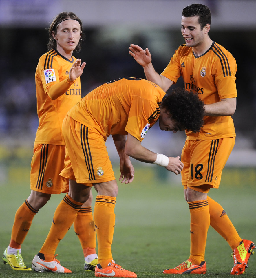 Photo - Real Madrid's Pepe of Portugal, center,  celebrates his goal and the third of his team with Luka Modric of Croatia, left, and Jose Nacho, after scoring against Real Sociedad, during their Spanish League soccer match, at Anoeta stadium, in San Sebastian, Spain, Saturday, April 5, 2014. (AP Photo/Alvaro Barrientos)