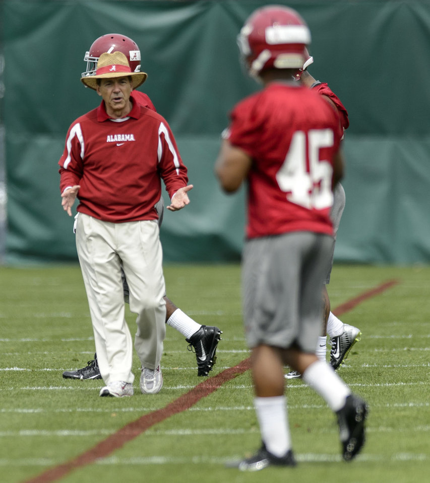 Photo - Alabama head coach Nick Saban works with the defensive backs during spring NCAA college football practice, Saturday, March 15, 2014, at the Thomas-Drew Practice Facility in Tuscaloosa, Ala. (AP Photo/Alabama Media Group, Vasha Hunt) MAGS OUT