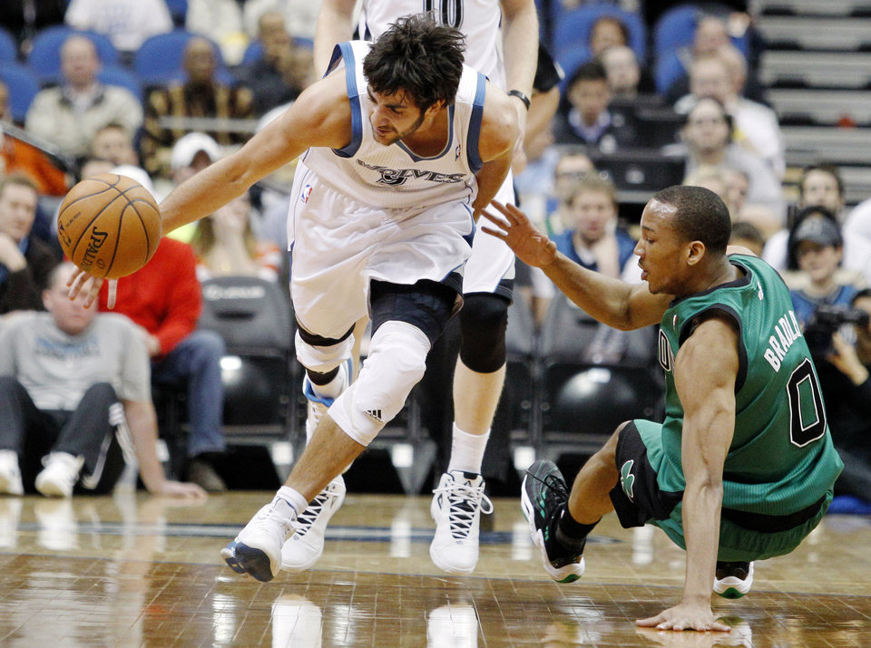 Photo - Minnesota Timberwolves guard Ricky Rubio (9), of Spain, maneuvers around Boston Celtics guard Avery Bradley (0) during the first half of an NBA basketball game Monday, April 1, 2013, in Minneapolis. (AP Photo/Genevieve Ross)