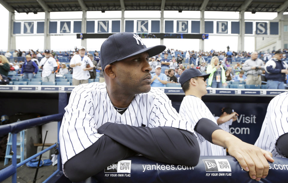 Photo - New York Yankees starting pitcher CC Sabathia stands in the dugout before an exhibition baseball game against the Pittsburgh Pirates Thursday, Feb. 27, 2014, in Tampa, Fla. (AP Photo/Charlie Neibergall)