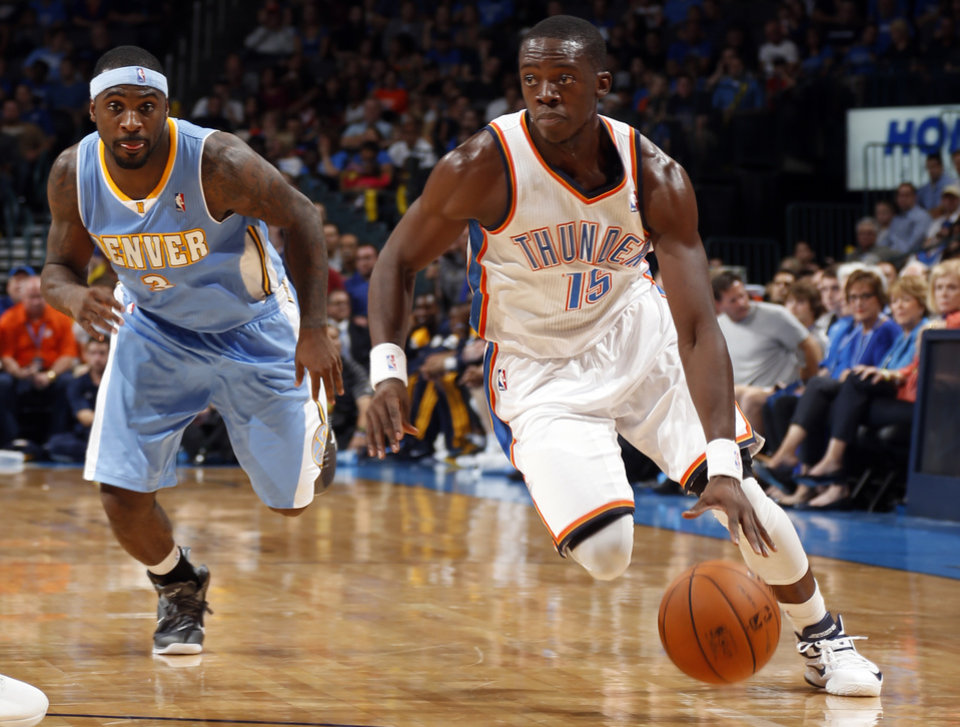 Oklahoma City's Reggie Jackson (15) drives to the basket past Denver's Ty Lawson (3) during the NBA preseason basketball game between the Oklahoma City Thunder and the Denver Nuggets at the Chesapeake Energy Arena, Sunday, Oct. 21, 2012. Photo by Sarah Phipps, The Oklahoman
