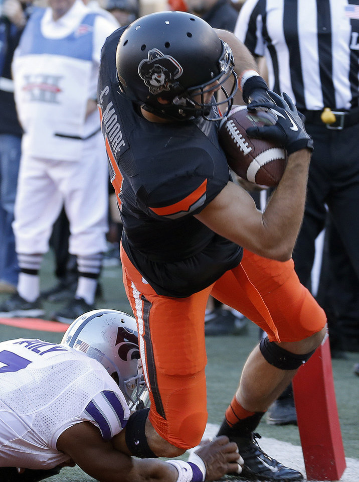 Oklahoma State's Charlie Moore (17) scores a touchdown as Kansas State's Kip Daily (7) tackles him during the second half of a college football game between the Oklahoma State University Cowboys (OSU) and the Kansas State University Wildcats (KSU) at Boone Pickens Stadium in Stillwater, Okla., Saturday, Oct. 5, 2013. OSU won 33-29.Photo by Sarah Phipps, The Oklahoman