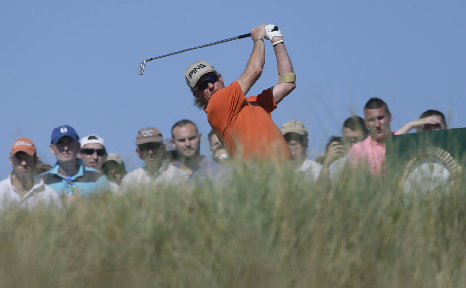 Photo - Miguel Angel Jimenez of Spain plays a shot from the 15th tee during the second round of the British Open Golf Championship at Muirfield, Scotland, Friday July 19, 2013. (AP Photo/Jon Super)