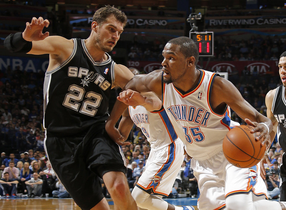 Photo - Oklahoma City's Kevin Durant (35) trie to get past San Antonio's Tiago Splitter (22) during an NBA basketball game between the Oklahoma City Thunder and the San Antonio Spurs at Chesapeake Energy Arena in Oklahoma City, Thursday, April 3, 2014. Photo by Bryan Terry, The Oklahoman