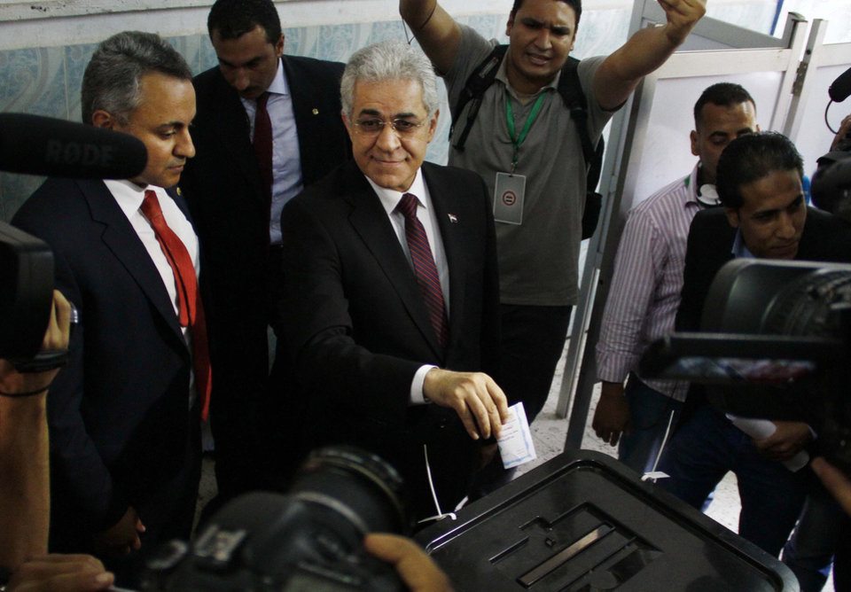 Photo - Presidential candidate Hamdeen Sabahi poses for photographers before casting his ballot on the first day of the presidential elections in Cairo, Egypt, Monday, May 26, 2014. Retired military chief Field Marshal Abdel-Fattah el-Sissi is practically assured of a victory in the vote, which is being held over two days, Monday, 26, and Tuesday, 27. The only other candidate in the race is leftist politician Sabahi, who finished third in the 2012 presidential election. (AP Photo/Ahmed Abdel Fattah, El Shorouk Newspaper) EGYPT OUT