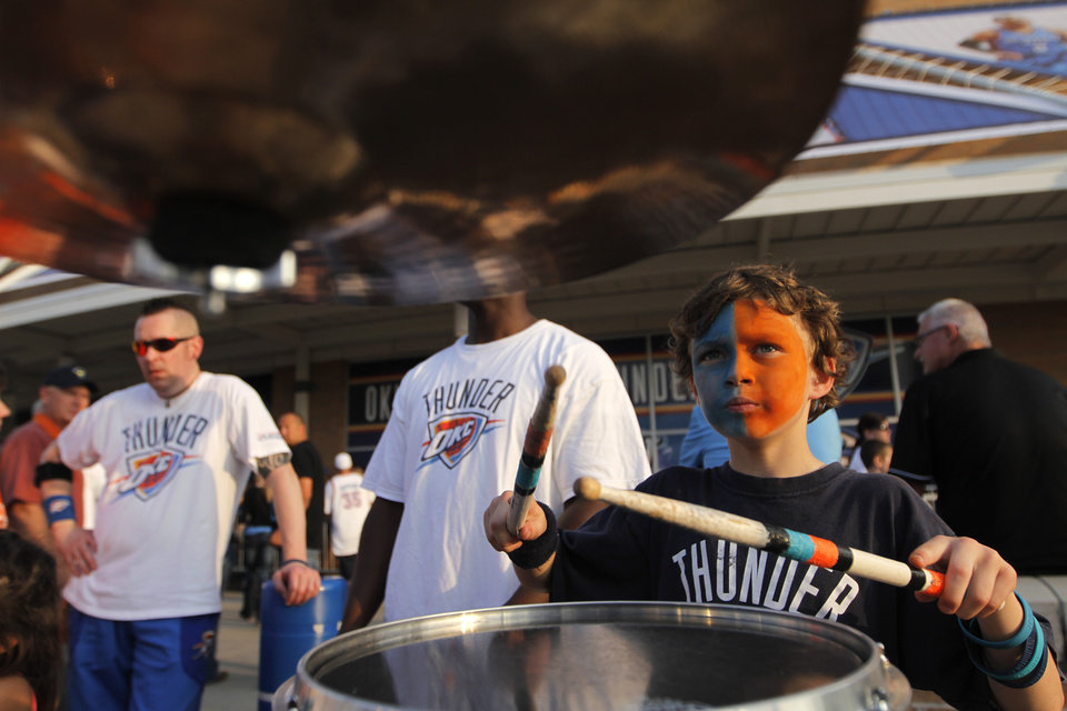Lawson Lewis, 7, of Oklahoma City, plays the drums at Love's Thunder Alley, Monday, April 30, 2012.  Photo by Garett Fisbeck, For The Oklahoman