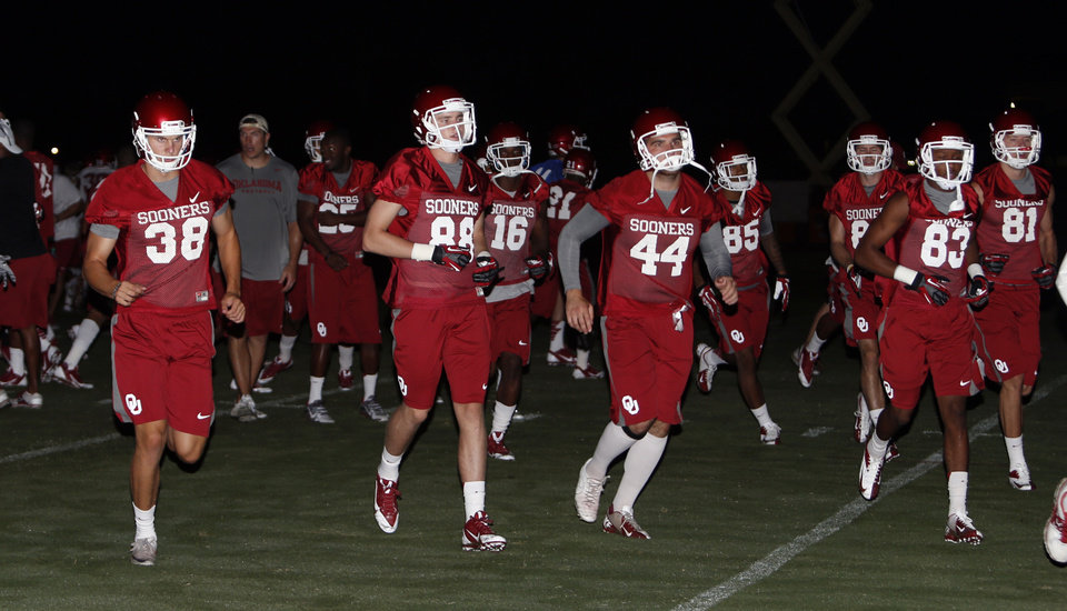 Sooner Players attend pre-dawn drills for the University of Oklahoma (OU) in Norman, Okla., Friday, Aug. 2, 2013. Photo by Steve Sisney, The Oklahoman