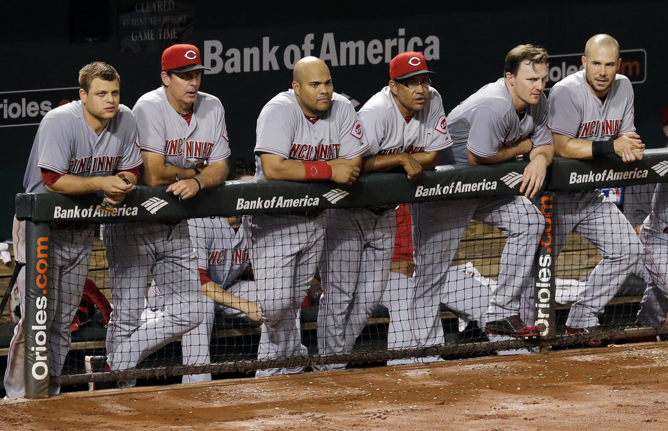 Photo - Members of the Cincinnati Reds watch from the dugout in the ninth inning of an interleague baseball game against the Baltimore Orioles, Wednesday, Sept. 3, 2014, in Baltimore. Baltimore won 5-4. (AP Photo/Patrick Semansky)