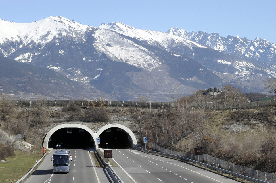 A bus with the relatives of victims leaves the tunnel after they paid tribute at the site of the accident in Sierre, western Switzerland, Thursday, March 15, 2012. Twenty-eight people, including 22 children, returning to Belgium from a skiing holiday died in a bus accident in Sierre in the Swiss canton of Valais, Swiss police said Wednesday. (AP Photo/Keystone, Olivier Maire) ORG XMIT: SIO503