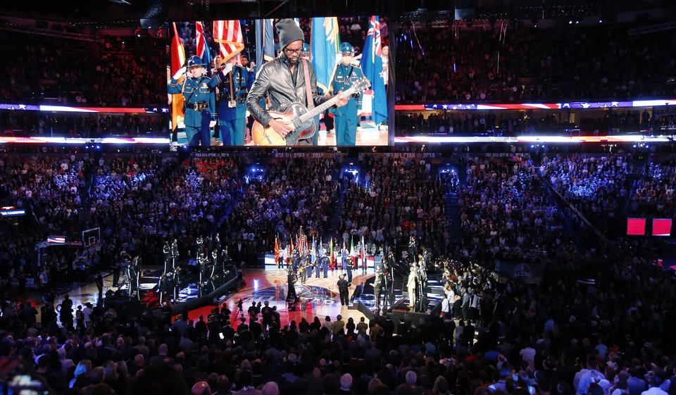 Photo - The National anthem is played during the NBA All Star basketball game, Sunday, Feb. 16, 2014, in New Orleans. (AP Photo/Bill Haber)