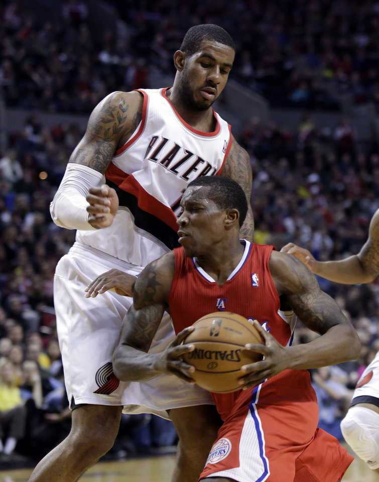 Los Angeles Clippers guard Eric Bledsoe, right, drives past Portland Trail Blazers forward LaMarcus Aldridge during the first quarter of an NBA basketball game in Portland, Ore., Saturday, Jan. 26, 2013. (AP Photo/Don Ryan)