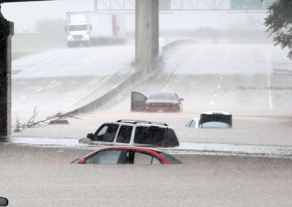 Cars are almost covered in water under the railroad bridge at the Broadway Extension in Oklahoma City, OK, Monday, June 14, 2010. By Paul Hellstern, The Oklahoman