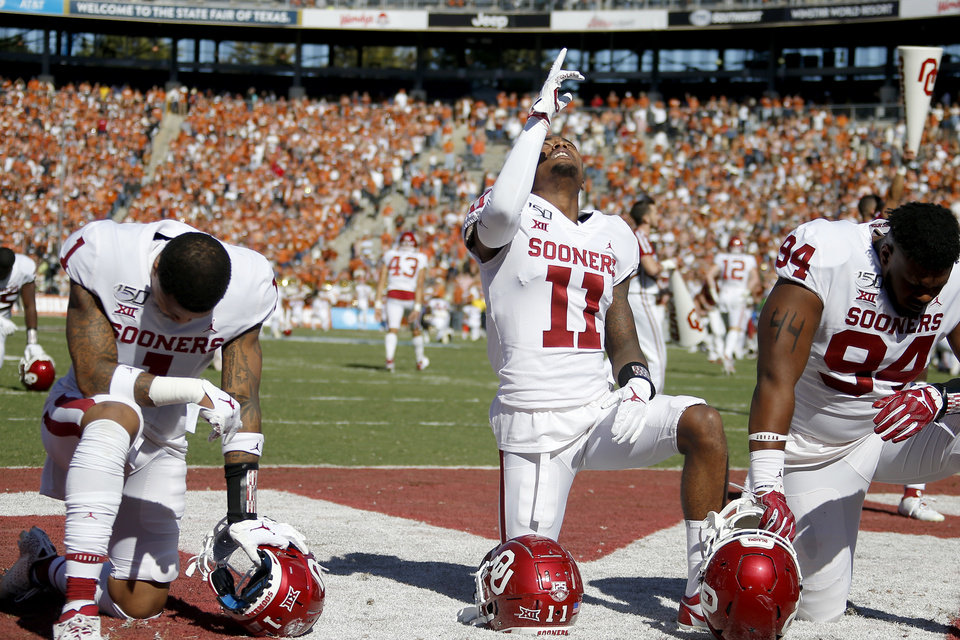 Photo - Oklahoma's Parnell Motley gestures after a prayer before a game in October against Texas. Motley was ejected from Saturday's game against Kansas State after kicking a Wildcat player. [Bryan Terry/The Oklahoman]